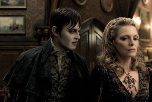 Johnny Depp looks hungrily at Michelle Pfeiffer in Dark Shadows | Warner Bros.