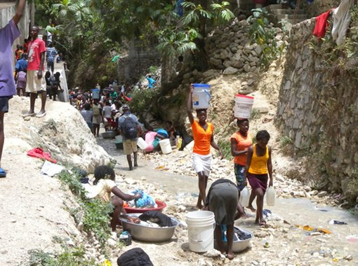Haitians carrying water