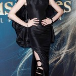 Anne Hathaway in Tom Ford gown and bondage boots