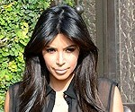 Kim Kardashian Shows Off Baby Bump in Sheer Top