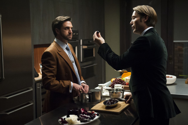 "Raul Esparza as Dr. Frederick Chilton and Mads Mikkelsen as Hannibal Lecter on ""Hannibal"" season one"