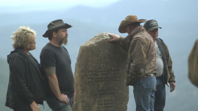 The guys pay their respects to miners everywhere by erecting a monument.