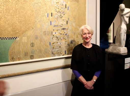 """Helen Mirren poses with the famed """"Woman in Gold"""" painting 