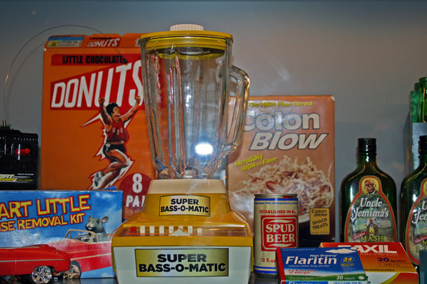 A display of some of our favorite products from SNL's parody commercials - Little Chocolate Donuts cereal, Super Bass-O-Matic, and Colon Blow at Saturday Night Live: The Exhibition | Melanie Votaw Photo