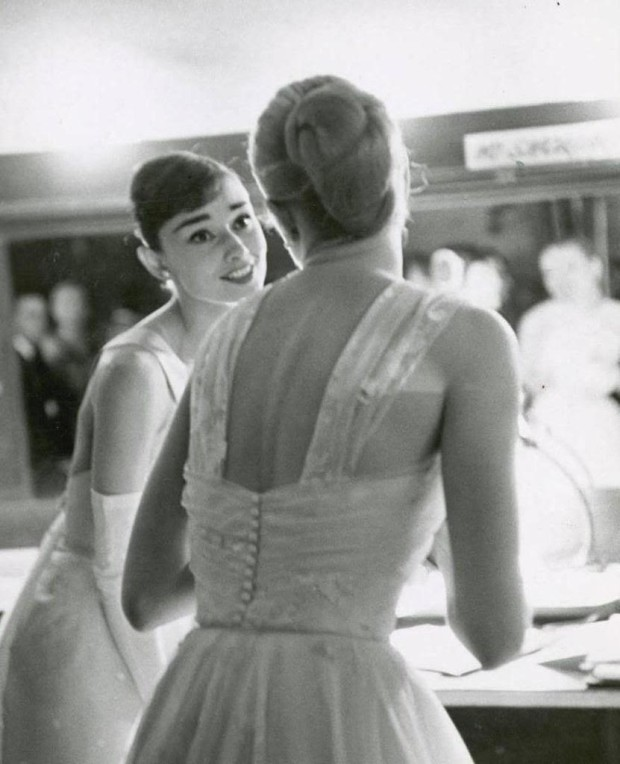 Audrey Hepburn and Grace Kelly, Backstage at the Oscars, circa 1956 | Allan Grant Photo
