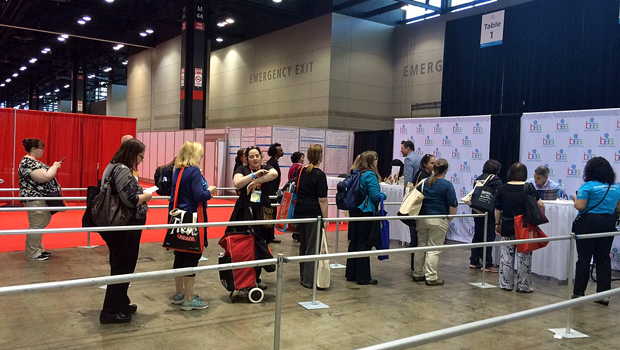 Attendees stand in line to get a signed copy of a book | Melanie Votaw Photo