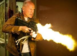 bruce willis shoots fire in Looper