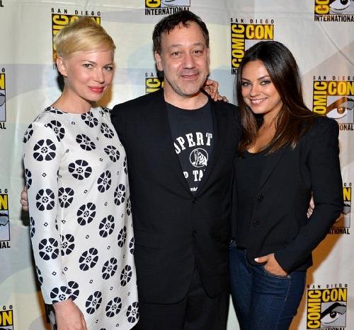 Michelle Williams, Sam Raimi and Mila Kunis at Comic-Con 2012 | WireImage
