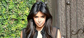 Pregnant Kim Kardashian Shows Off Curves