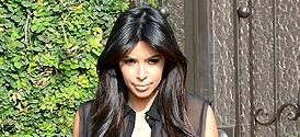 Pregnant Kim Kardashian Shows Off Curves