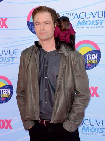 "Justin Kirk and Crystal, his former costar on ""Animal Practice,"" arrive for the 2012 Teen Choice Awards 