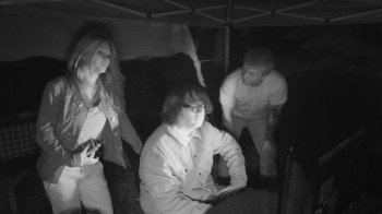 Ashton alerts Kristen and Patrick that a shadow figure is watching them.