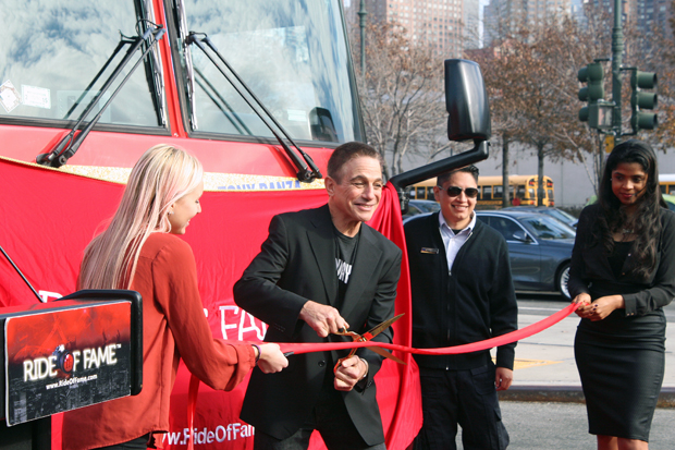 Tony Danza cuts the ribbon to dedicate the doubledecker bus in New York that carries his name and image | Melanie Votaw Photo
