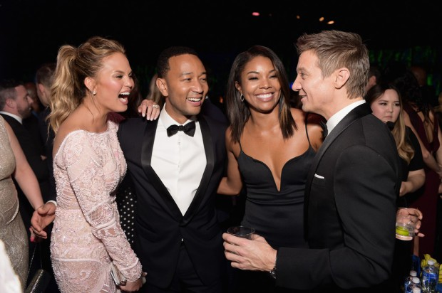 BEVERLY HILLS, CA - JANUARY 11:  Model Chrissy Teigen, singer John Legend and actors Gabrielle Union and Jeremy Renner (L-R) attend the 2015 InStyle And Warner Bros. 72nd Annual Golden Globe Awards Post-Party at The Beverly Hilton Hotel on January 11, 2015 in Beverly Hills, California.  (Photo by Stefanie Keenan/Getty Images for InStyle); Sent to by and used with permission from Slate PR