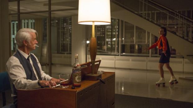John Slattery as Roger Sterling and Elisabeth Moss as Peggy Olson - Mad Men _ Season 7B, Episode 12 - Photo Credit: Justina Mintz/AMC