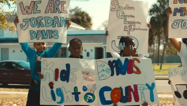 """A still from """"3 1/2 Minutes, 10 Bullets"""" shows protesters outside of the courthouse during the trial of Michael Dunn"""