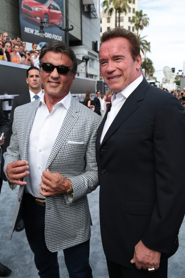 """Sylvester Stallone and Arnold Schwarzenegger pose together as Paramount Pictures presents the Los Angeles premiere of """"Terminator Genisys"""" at the Dolby Theatre in Los Angeles, California on Sunday, June 28, 2015. (Photo: Alex J. Berliner/ABImages)"""