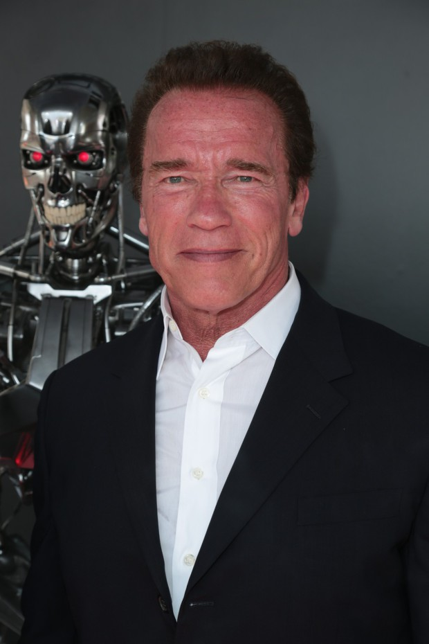 """Arnold Schwarzenegger with Model T-800 Terminator as Paramount Pictures presents the Los Angeles premiere of """"Terminator Genisys"""" at the Dolby Theatre in Los Angeles, California on Sunday, June 28, 2015. (Photo: Alex J. Berliner/ABImages)"""