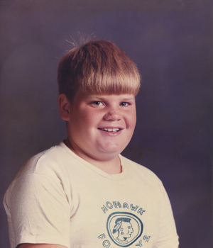 Chris Farley as a young boy