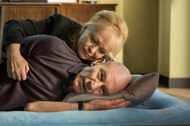 "Jacki Weaver as Rosalie spoons Patrick Stewart as Walter Blunt in ""Blunt Talk"""